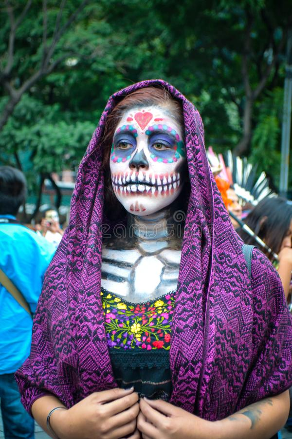 Mexico City, Mexico, ; October 26 2016: Portrait of a woman in disguise at the Day of the Dead parade in Mexico City stock image
