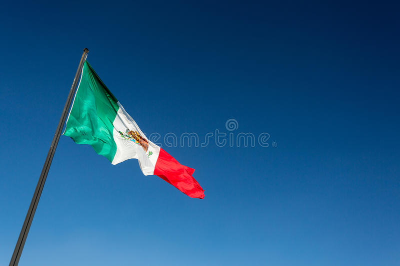 Mexico flag. On a clear blue sky stock image