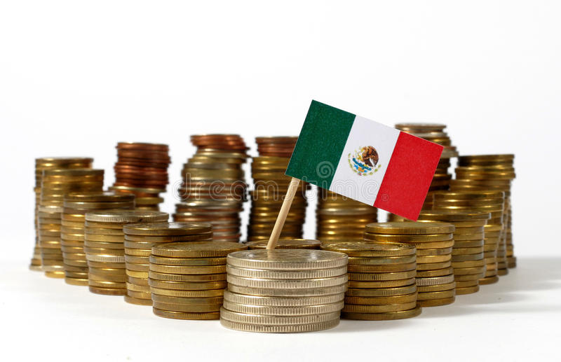 Mexico flag with stack of money coins stock photo