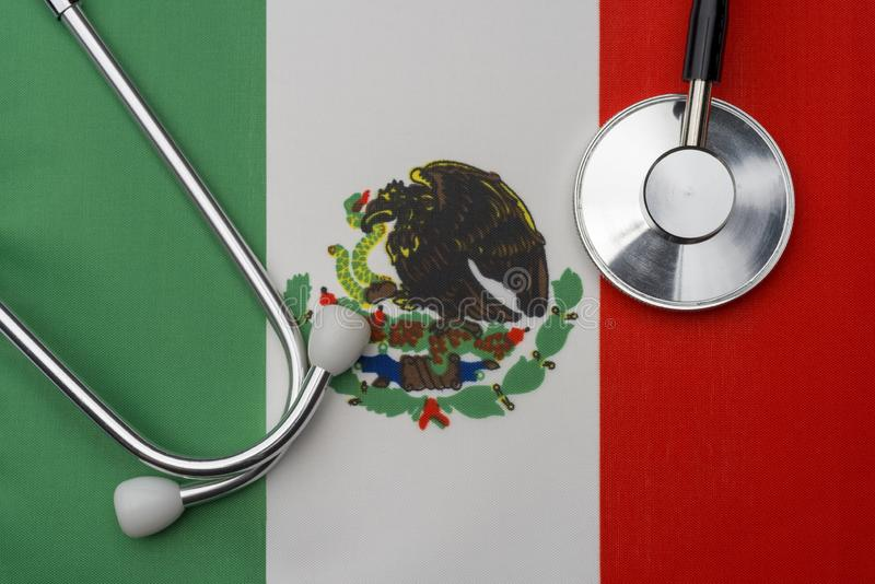 Mexico flag and stethoscope. The concept of medicine stock image