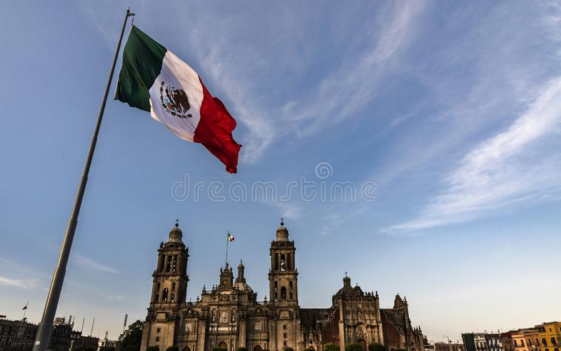 Mexico City, flag of the wind mexico,. Mexico flag in the wind the background the cathedral in Mexico City royalty free stock image