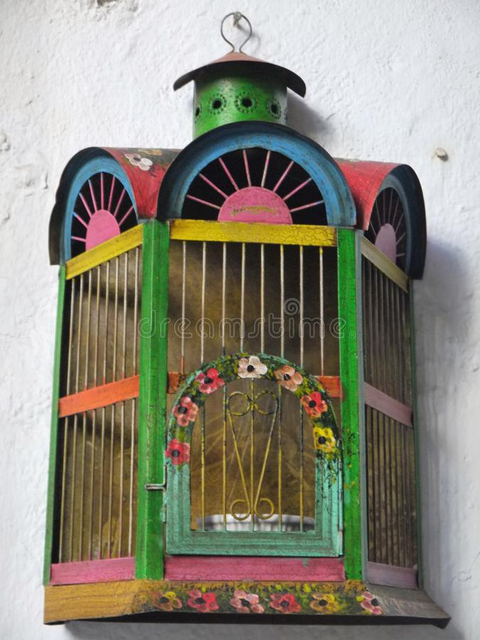 Mexico: handcrafted painted metal bird cage royalty free stock photos
