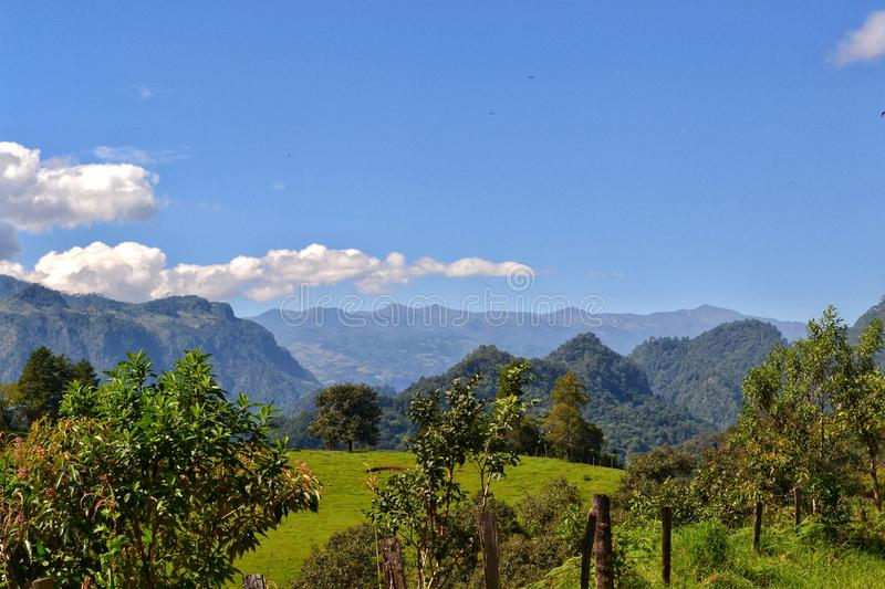 Nature landscape, mountains from xalapa mexico. Mexico landscape between the green of the vegetation and the blue sky with the peak of Orizaba royalty free stock photo