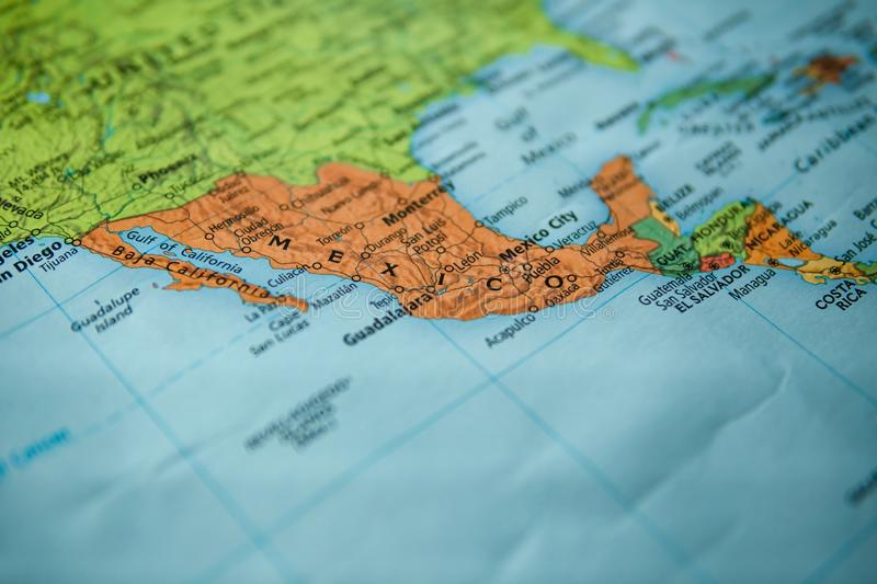 Mexico on a map. Selective focus on label stock images