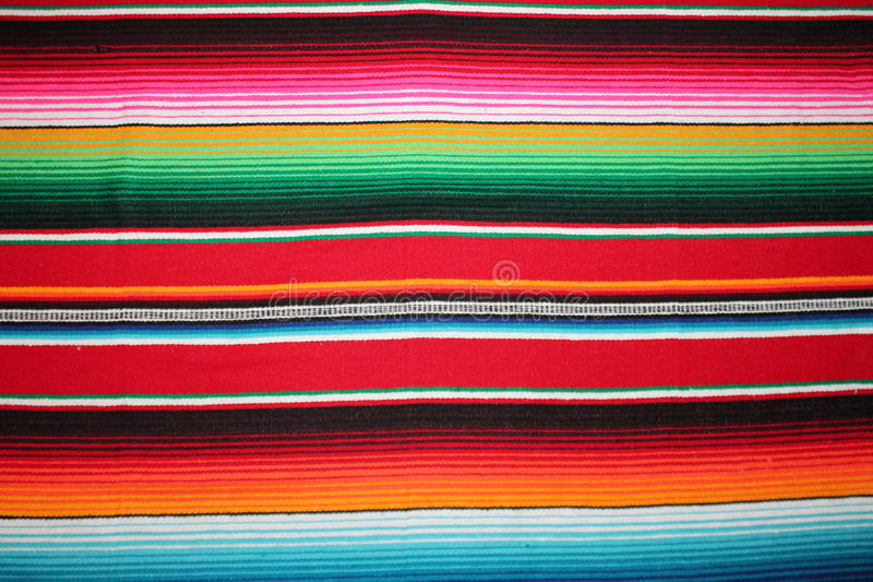 Poncho background Mexico Mexican traditional cinco de mayo blanket fiesta with stripes. Poncho background Mexican Mexico cinco de mayo rug blanket fiesta serape royalty free stock images