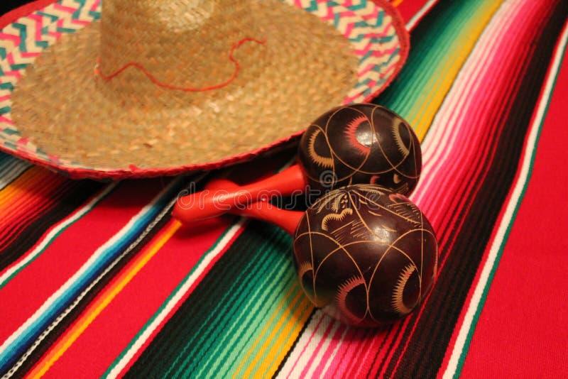 Mexico poncho sombrero maracas background fiesta cinco de mayo decoration bunting royalty free stock images