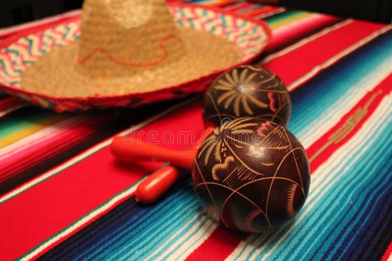 Mexico poncho sombrero maracas background fiesta cinco de mayo decoration bunting papel picado royalty free stock photo