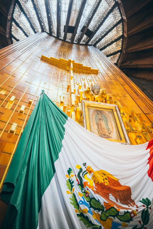 MEXICO - SEPTEMBER 20: Cross, image of the virgin of Guadalupe and Mexican flag at Basilica of our Lady Guadalupe. The day after the earthquake, Mexico city stock photo