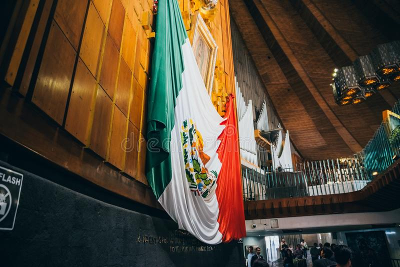 MEXICO - SEPTEMBER 20: Image of the virgin of Guadalupe and Mexican flag at Basilica of our Lady Guadalupe. The day after the earthquake, Mexico city, September royalty free stock photography