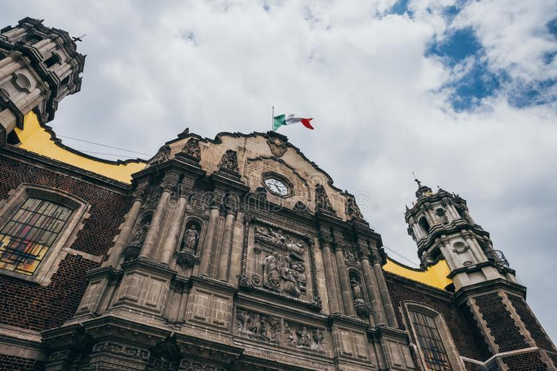 MEXICO - SEPTEMBER 20: Mexican flag on old Basilica of our Lady Guadalupe the day after the earthquake. Mexico city, September 20, 2017 stock photos