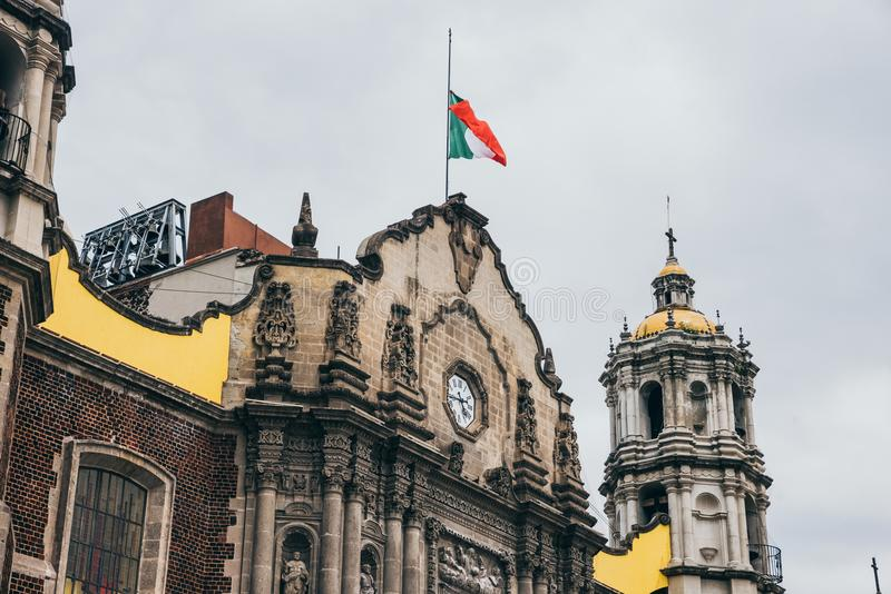 MEXICO - SEPTEMBER 20: Mexican flag on old Basilica of our Lady Guadalupe. The day after the earthquake, Mexico city, September 20, 2017 stock photo