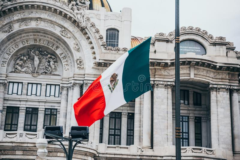 MEXICO - SEPTEMBER 20: Mexican flag at the Palace of Fine Arts. Plaza, September 20, 2017 in Mexico City, Mexico royalty free stock photos