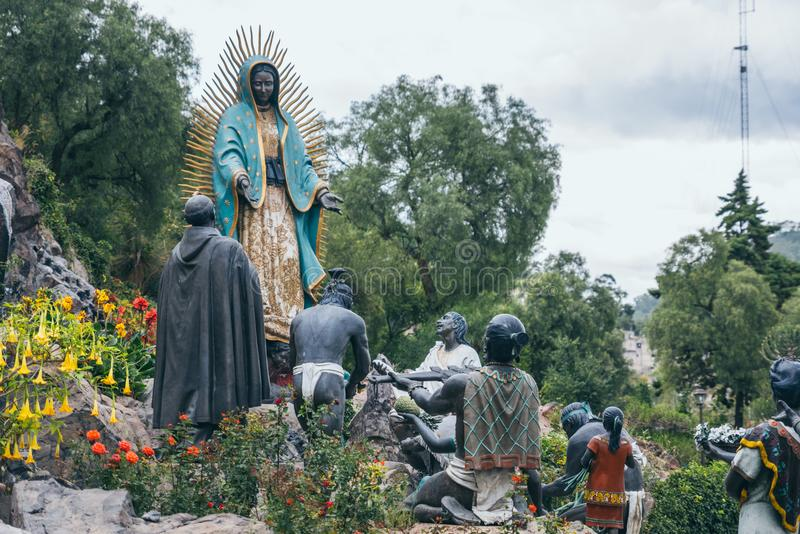 MEXICO - SEPTEMBER 20: Sculpture of Aztec people worshipping the virgin Mary. Located at the Tepeyac Hills, September 20, 2017 in Mexico City, Mexico royalty free stock photos