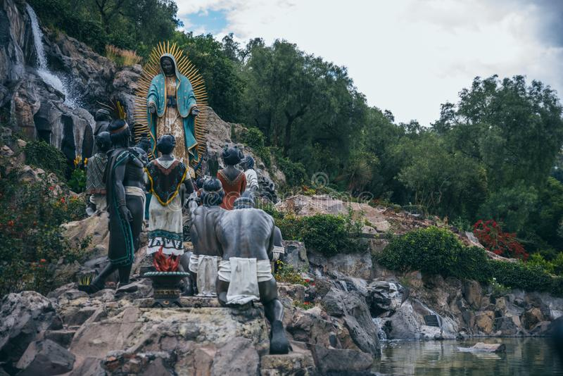MEXICO - SEPTEMBER 20: Sculpture of Aztec people worshipping the virgin Mary. Located at the Tepeyac Hills, September 20, 2017 in Mexico City, Mexico royalty free stock photo