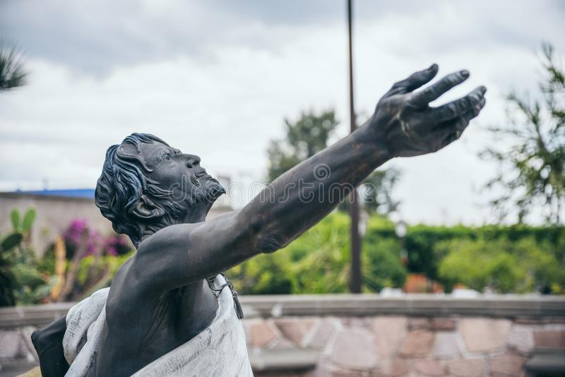 MEXICO - SEPTEMBER 20: Statue of a man with a cross looking at the sky stock images