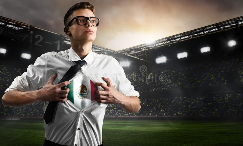 Mexico soccer or football supporter showing flag. Under his business shirt on stadium stock photos