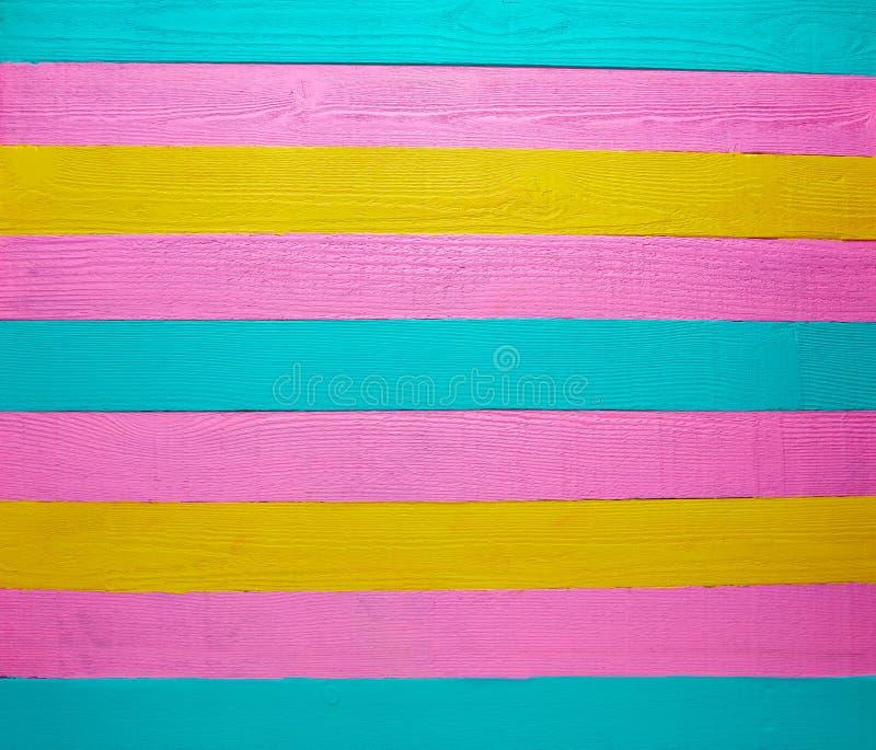 Mexikanisches hölzernes Hintergrundgrün-Rosagelb stockbild