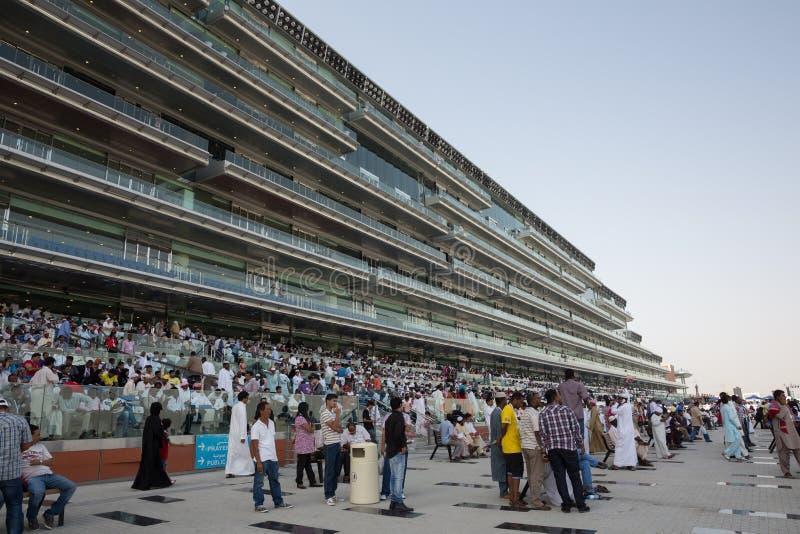 Meydan Racecourse. People at Meydan Racecourse in Meydan City, Dubai, United Arab Emirates on Dubai World Cup Day. It is able to accommodate over 60,000 royalty free stock photos