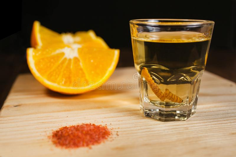 Mezcal shot mexican drink with orange and worm salt in oaxaca mexico. Mezcal mexican drink with orange slices and worm salt in oaxaca mexico, mescal beverages royalty free stock image