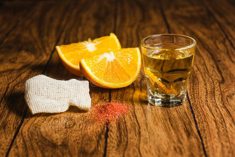 Mezcal shot mexican drink with orange and worm salt in oaxaca mexico. Mezcal mexican drink with orange slices and worm salt in oaxaca mexico, mescal beverages stock image