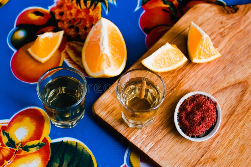 Mezcal shot with chili salt and agave worm, mexican drink in mexico royalty free stock photos