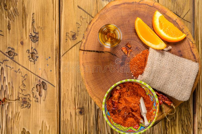 Mezcal shot mexican drink with orange slices, chili pepper and worm salt in oaxaca mexico. Top view with copy space . Flat lay. royalty free stock image