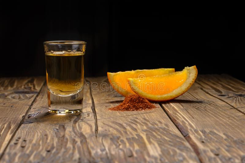 Mezcal shot with orange slices and worm salt. Mexican drink. stock photo