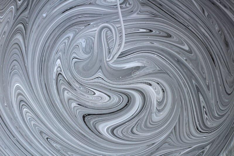 mezcla abstracta de la imagen de dos colores La textura de los círculos de la pintura blanca y negra fotografía de archivo libre de regalías