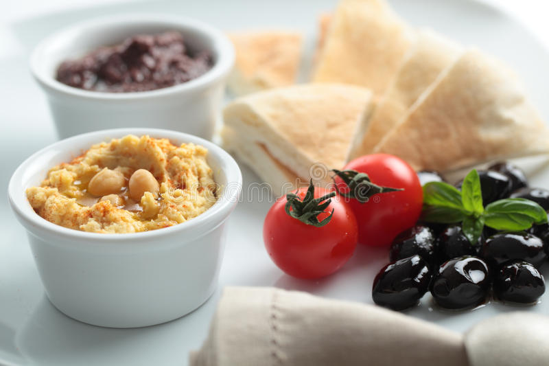 Meze with tomato, olives, and pita bread royalty free stock photography