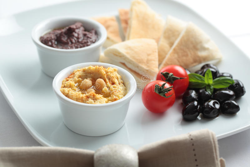 Meze with tomato, olives, and pita bread royalty free stock photos