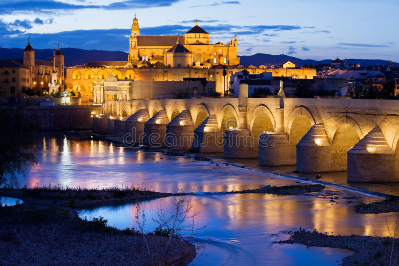 Mezquita and Roman Bridge in Cordoba. Roman Bridge on Guadalquivir river and Mezquita Cathedral (The Great Mosque) at twilight in the city of Cordoba, Andalusia royalty free stock photos