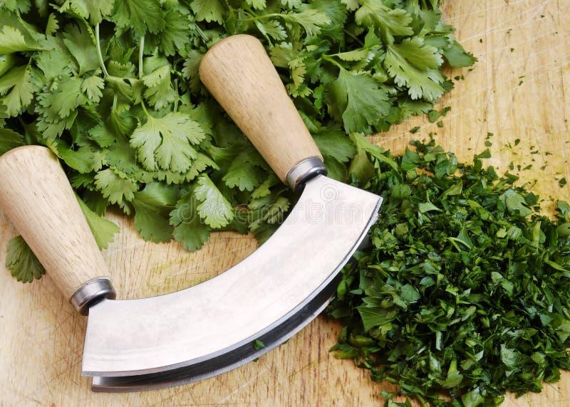 Download Mezzaluna and herbs stock photo. Image of mezzaluna, parsley - 3010210