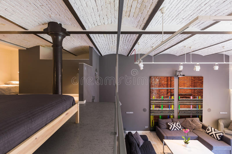 Mezzanine apartment in industrial style royalty free stock images