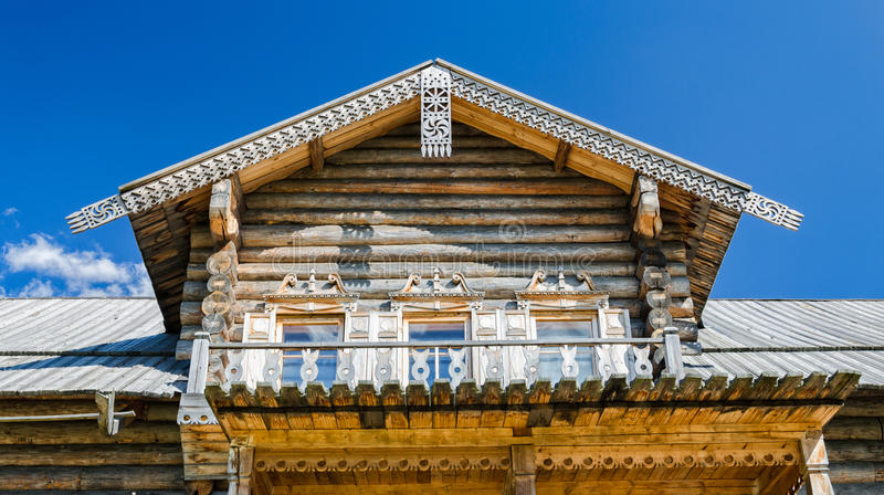The mezzanine of the peasant house with wooden carvings. Saint Petersburg suburbs, Russia. Bogoslovka manor complex. The mezzanine of the peasant house with royalty free stock photos