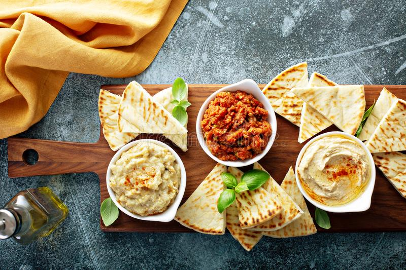 Mezze board with pita and dips royalty free stock images