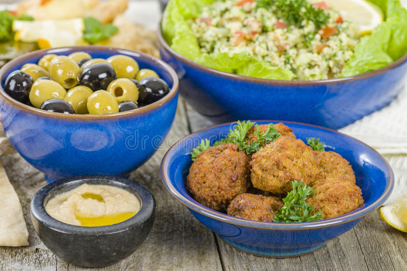 Mezze. Selection of Middle Eastern dishes. Tabbouleh, falafel, olives, sarma, spinach borek, fatayer, hummus and pita bread royalty free stock photo