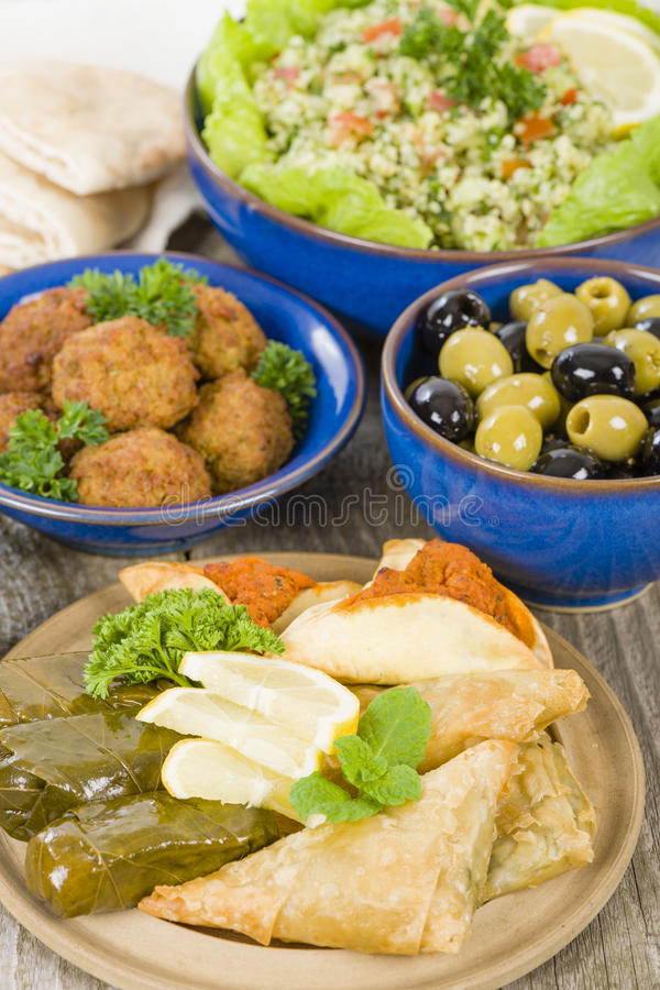 Mezze. Selection of Middle Eastern dishes. Tabbouleh, falafel, olives, sarma, spinach borek, fatayer, hummus and pita bread stock photography