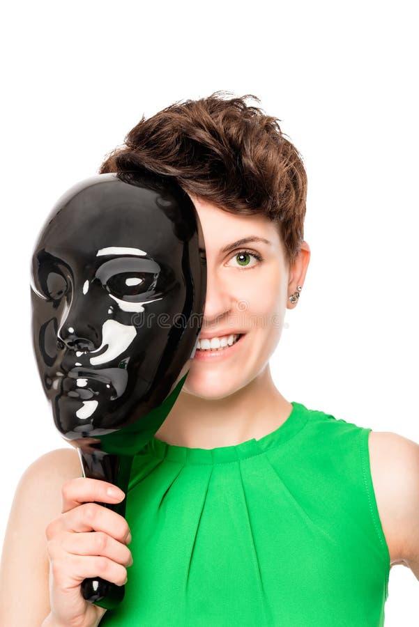 Mezzo fronte bello nascosto dietro la maschera immagine stock libera da diritti