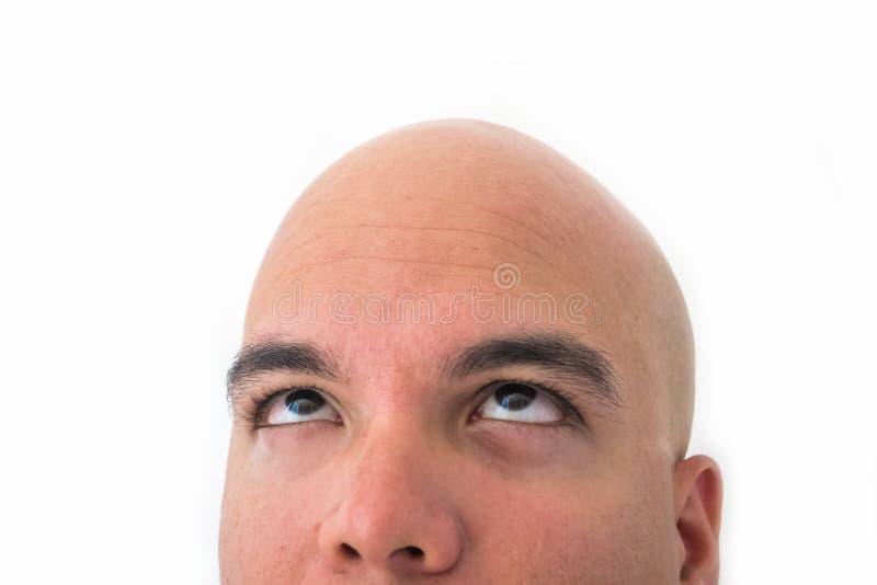 Mezzo fronte dell'uomo calvo nel fondo bianco fotografia stock