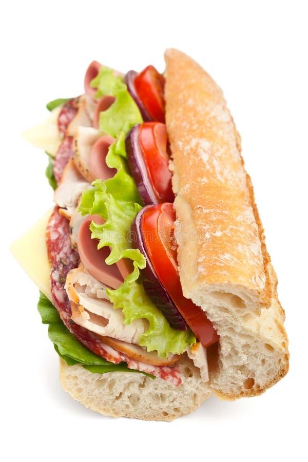 Mezzo panino delle carni delle baguette fotografie stock libere da diritti