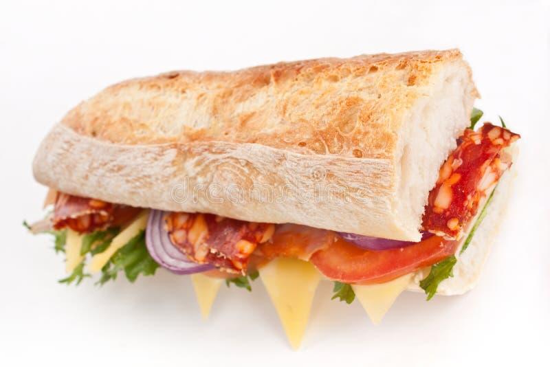 Mezzo panino delle carni delle baguette immagini stock libere da diritti