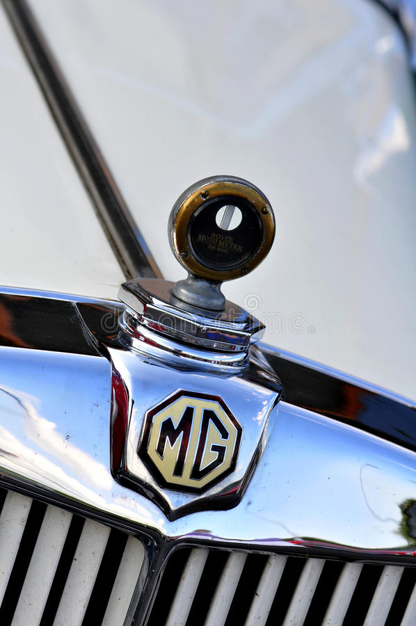 MG, logo on classic sport car. MG Cars is a former British sports car manufacturer, which was founded in 1924, the creator of the MG brand royalty free stock images