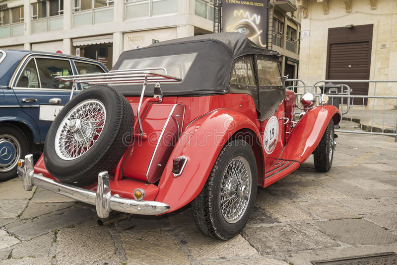 Mg topdowncruiser td roadster 1952. Red and spare wheel mg topdowncruiser td roadster 1952 stock images