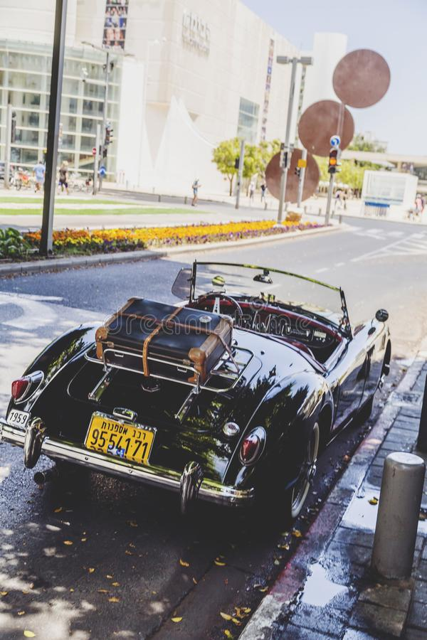 MG vintage car. Tel Aviv, Israel - June 9, 2018: Vintage and restored MG car parked on Rothschild Boulevard in Tel Aviv, Israel stock image