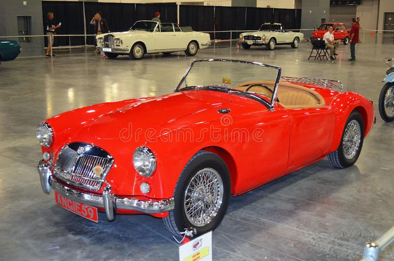 1959 MGA Roadster a Sports Car Classic. A totally restored bright red 1959 MGA Roadster on display at the International Auto Show at the Convention Center in royalty free stock image
