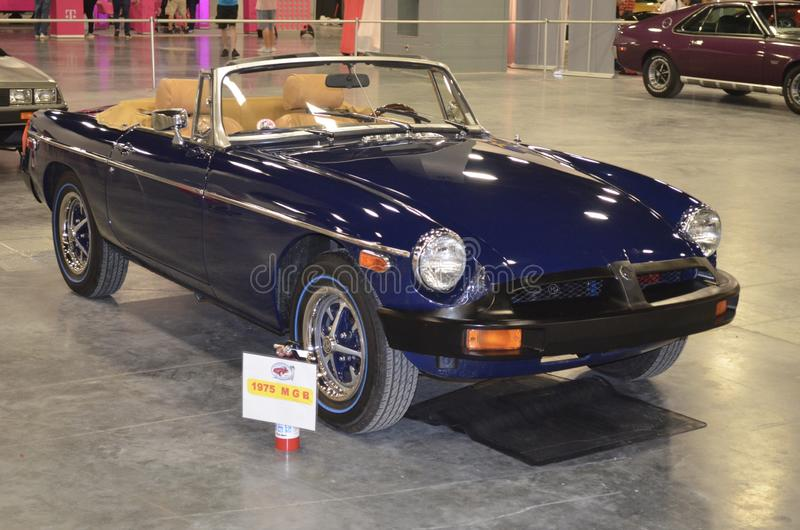 Blue 1981 MGB Roadster with Tan Leather Upholstery. A 1981 MGB Roadster on display at the 2018 International Auto Show at the Miami Beach Convention Center royalty free stock photography