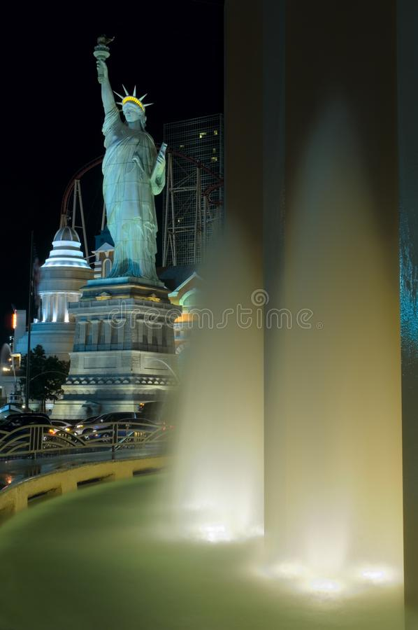 The MGM Hotel water fountains light up the Las Vegas Strip, along with a Statue of Liberty replica. royalty free stock photo