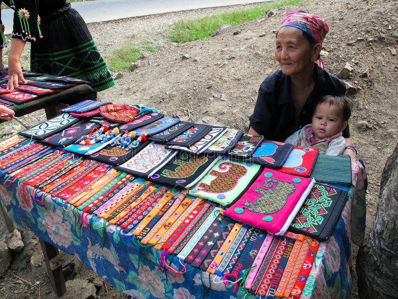 Mhong Routine Life selling craftwork. Mhong people in Luang Phra Bang, Laos sell their well-known craftwork in the village stock photography