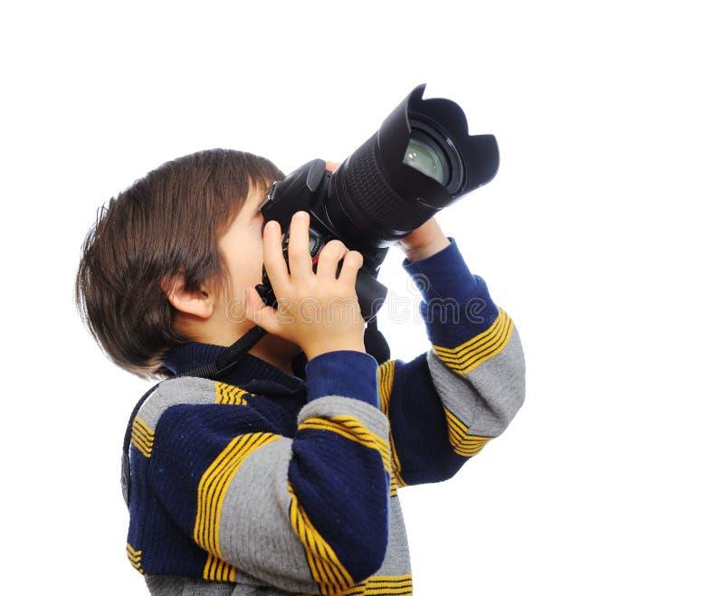 Miúdo com câmera fotografia de stock
