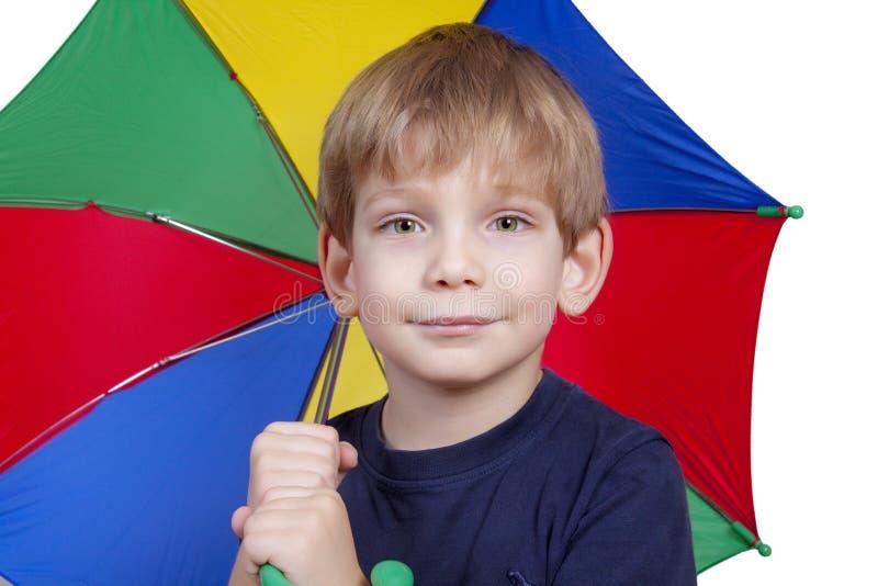 Miúdo com um guarda-chuva foto de stock royalty free